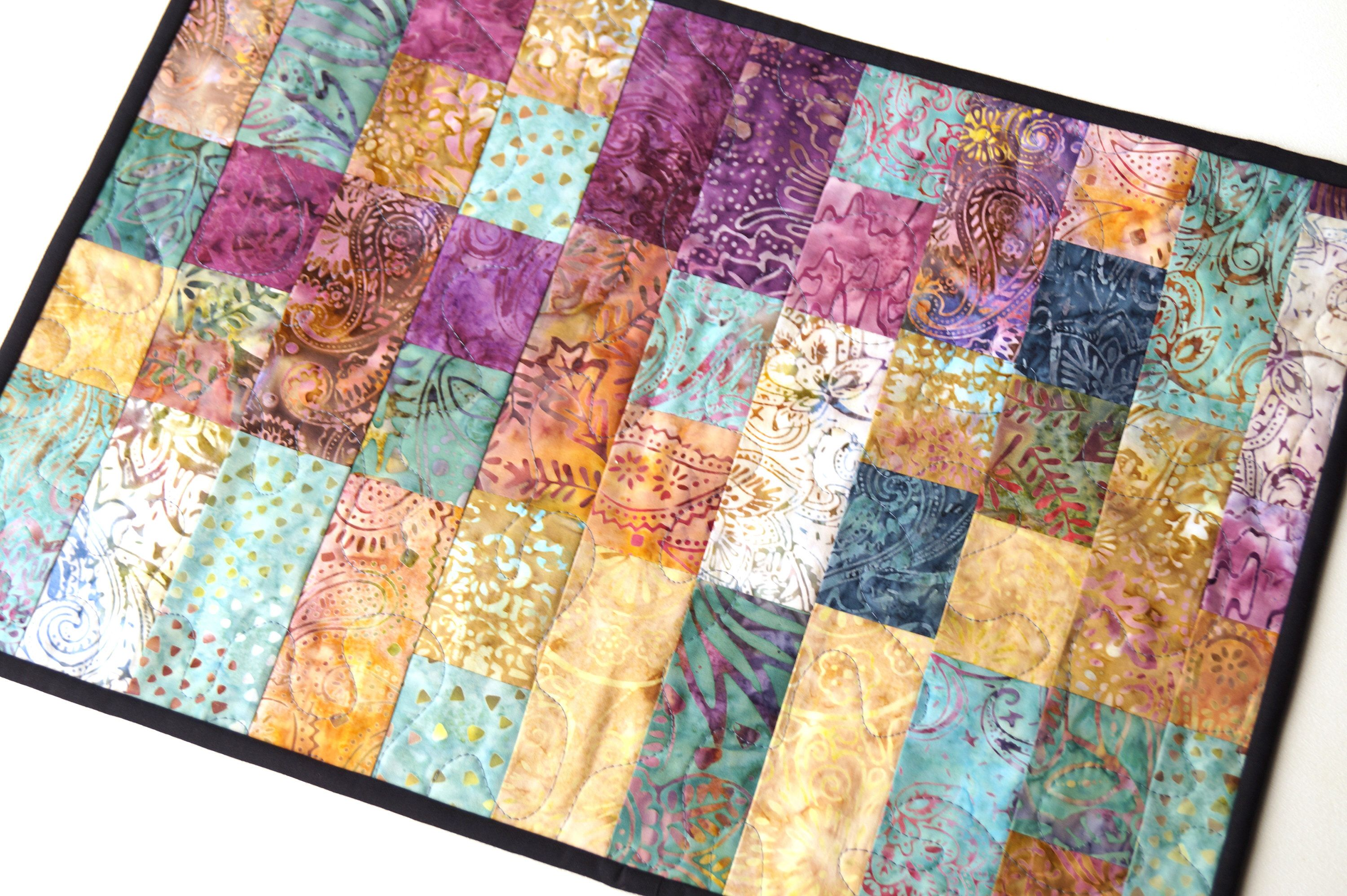 Batik Patchwork Mini Quilt or Large Place Mat in Quilted Fabrics in Shades of Pink, Purple, Blue, Aqua and Cream by MyBitOfWonder on Etsy https://www.etsy.com/listing/545642896/batik-patchwork-mini-quilt-or-large