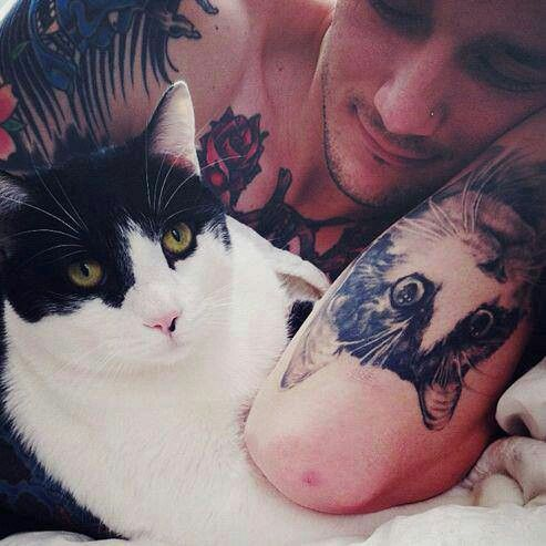 He's got a tattoo of his cat. Aww! :)