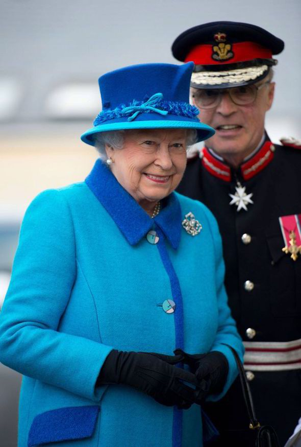 The Queen is all smiles in blue as she visits Cotts Farm Equine Hospital #visitwales