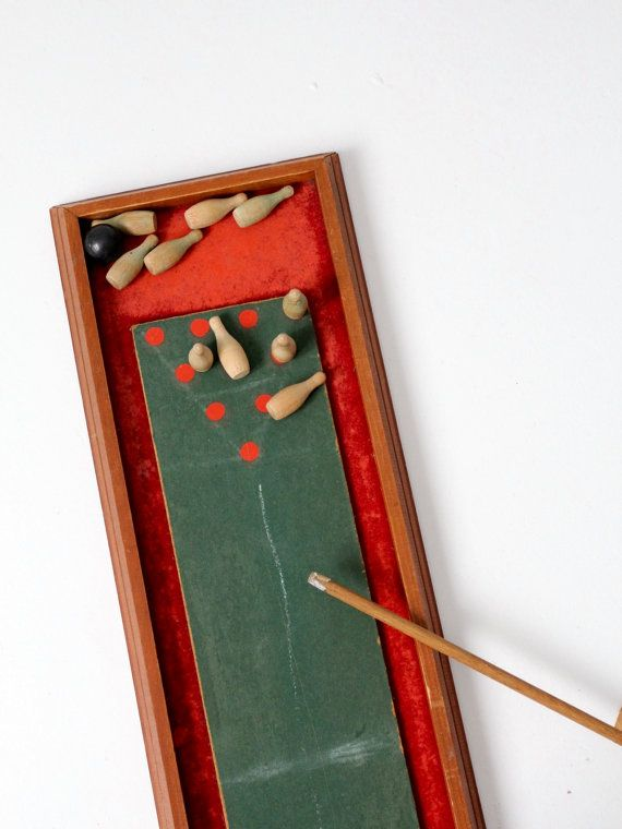 A Vintage Tabletop Bowling Game. A Slender Felted Wood Board Shapes The  Game With Small