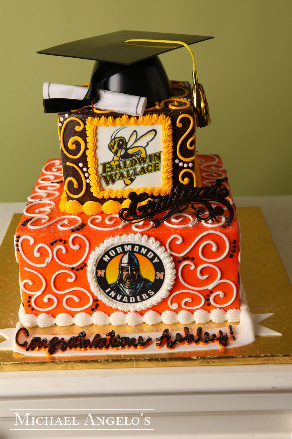 School Logos #18Graduation This two-tier cake is iced in ...
