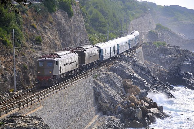 Wonderful image of the train along the coast of #Liguria - a trip I did many times when I was younger.