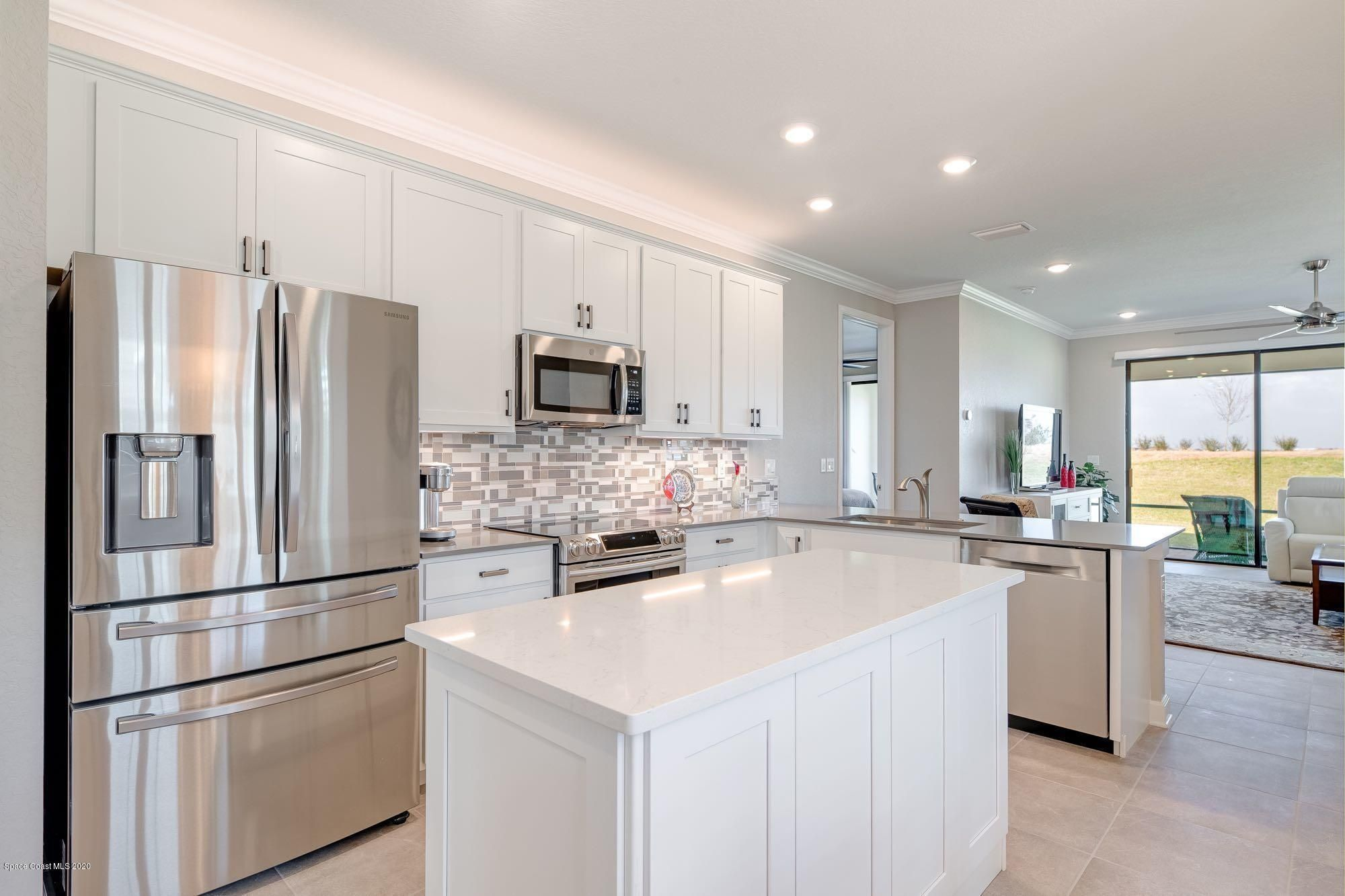 2640 Treasure Cay Lane Melbourne Fl 289 900 In 2020 Backsplash Designs Entry Doors With Glass Upgraded Appliances