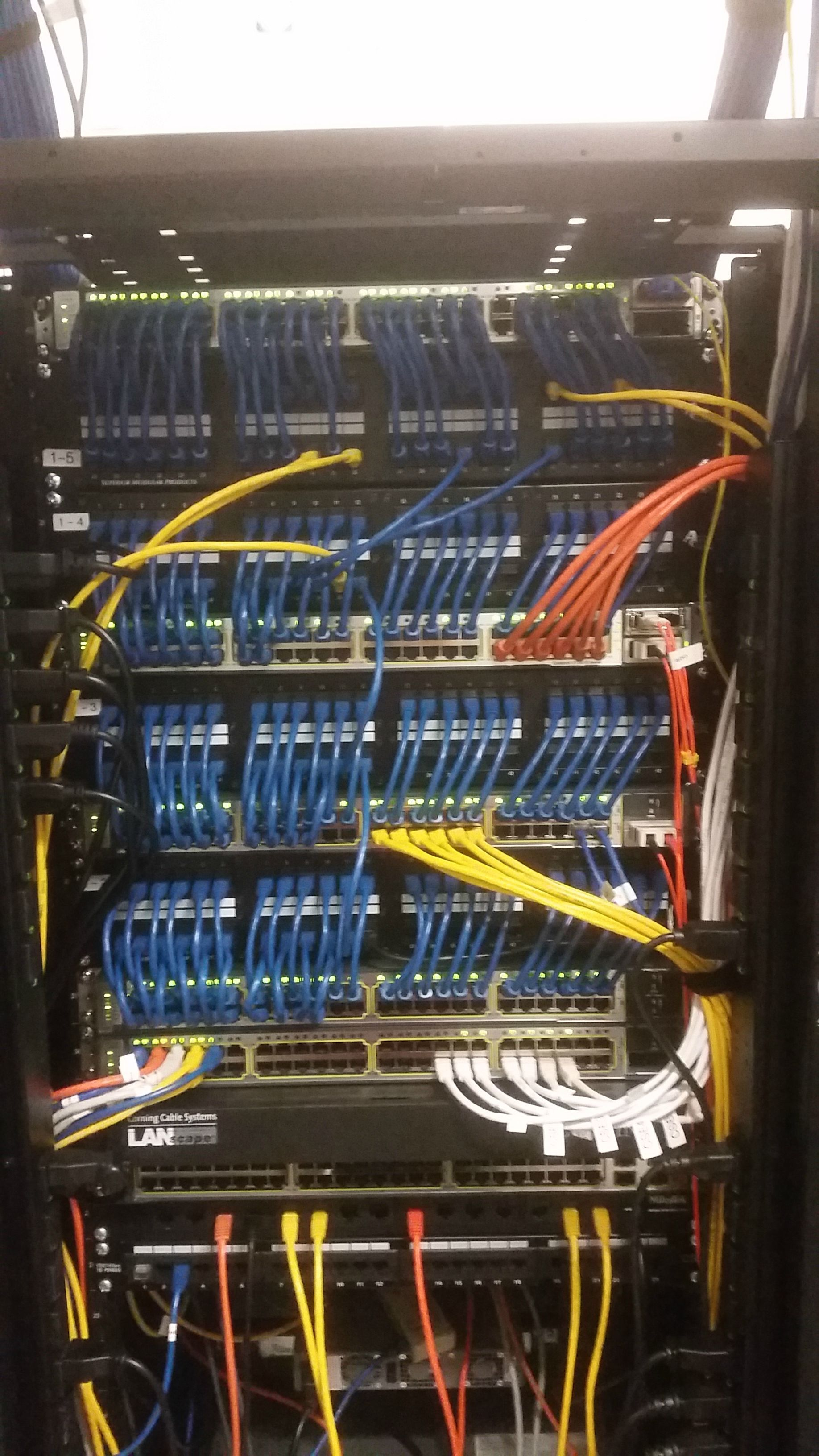 cleaning up a network rack cisco switches into patch panels clean job believe orange and yellow are powered but could be wrong  [ 1836 x 3264 Pixel ]