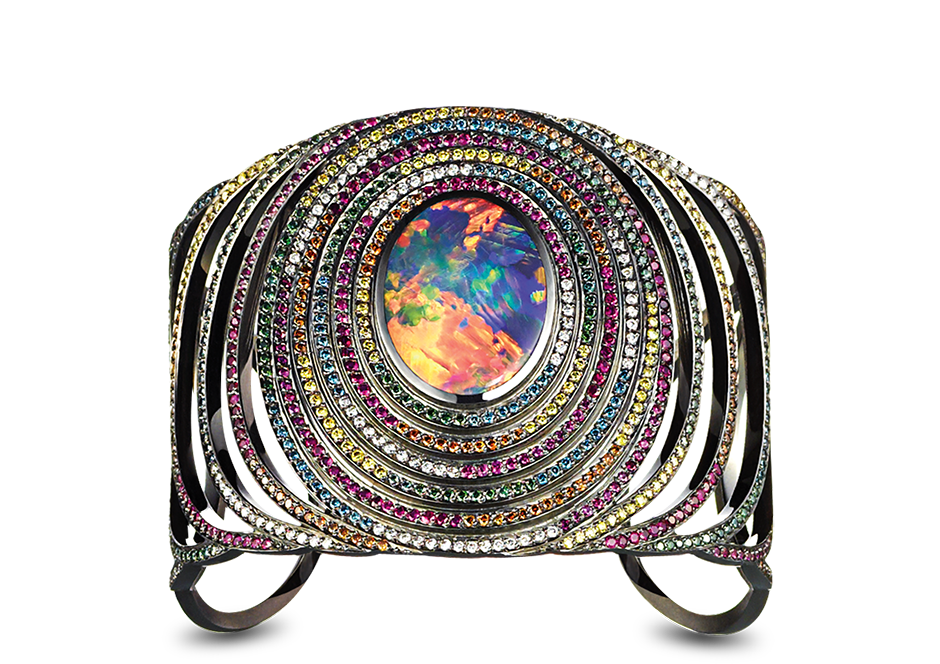 OPAL FRUIT CUFF-Solange Azagury-Partridge. An open work cuff set with an oval black Opal surrounded by tiers of Diamonds and precious stones in blackened 18ct white gold