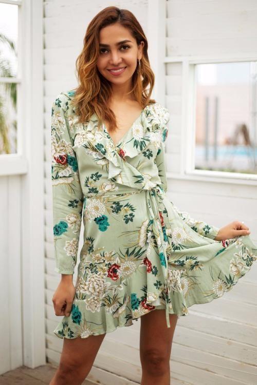 A wrap dress featuring ruffled neckline and hem 572613fd9