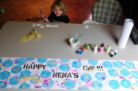 Kids can help make a homemade Mother's Day banner (for grandma)