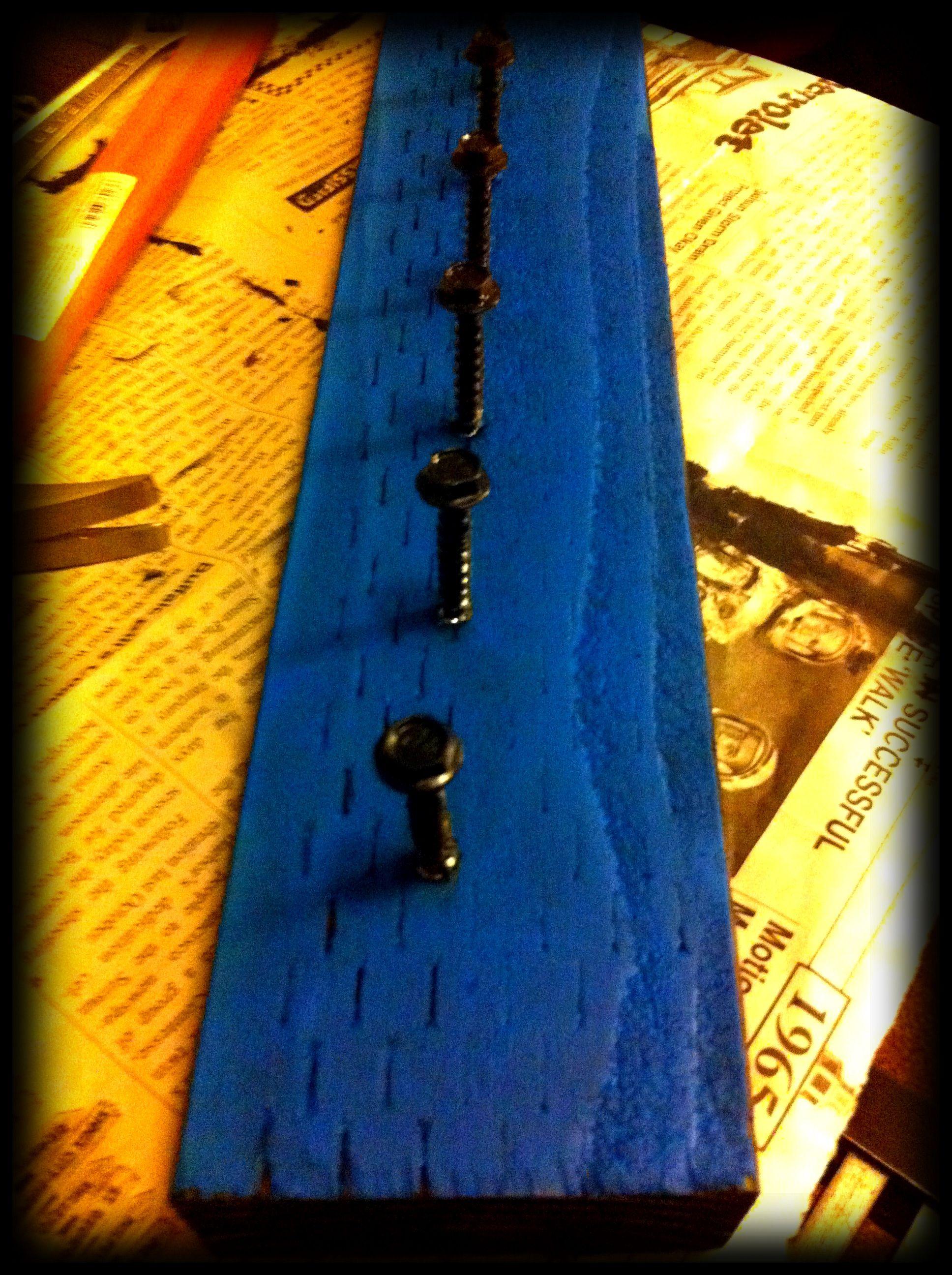 DIY hat rack- $.50 piece of scrap wood, $.19 screws, & paint