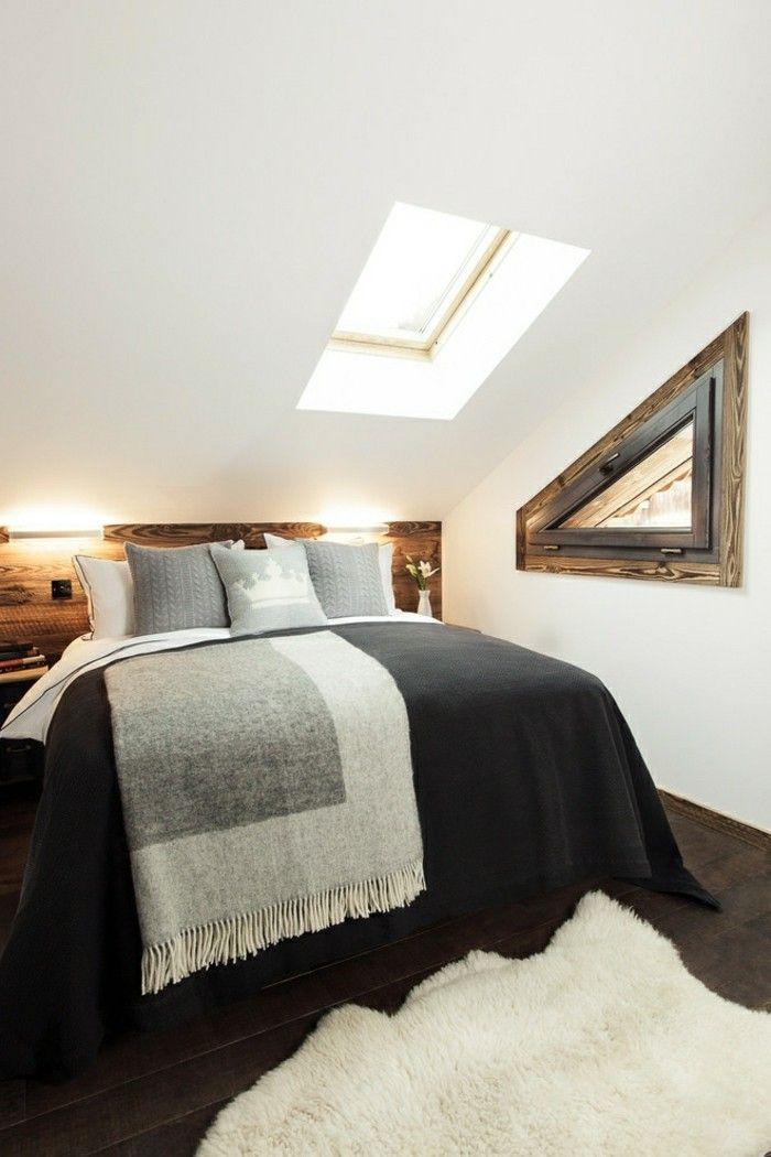 schlafzimmer dachschräge schwarze bettwäsche und weißer fellteppich