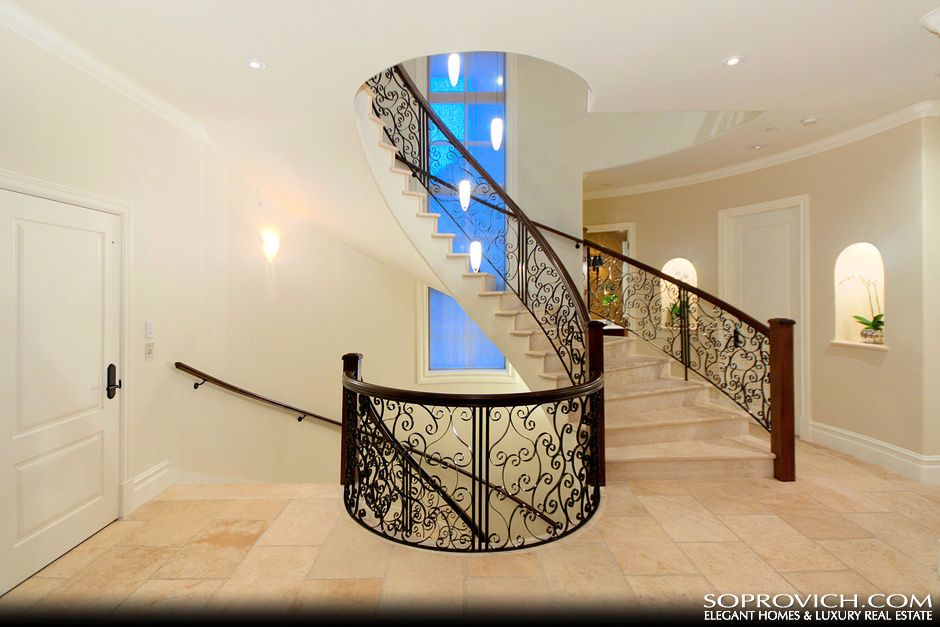 Curved Staircase With Solid Marble Treads And Custom Wrought Iron Railing