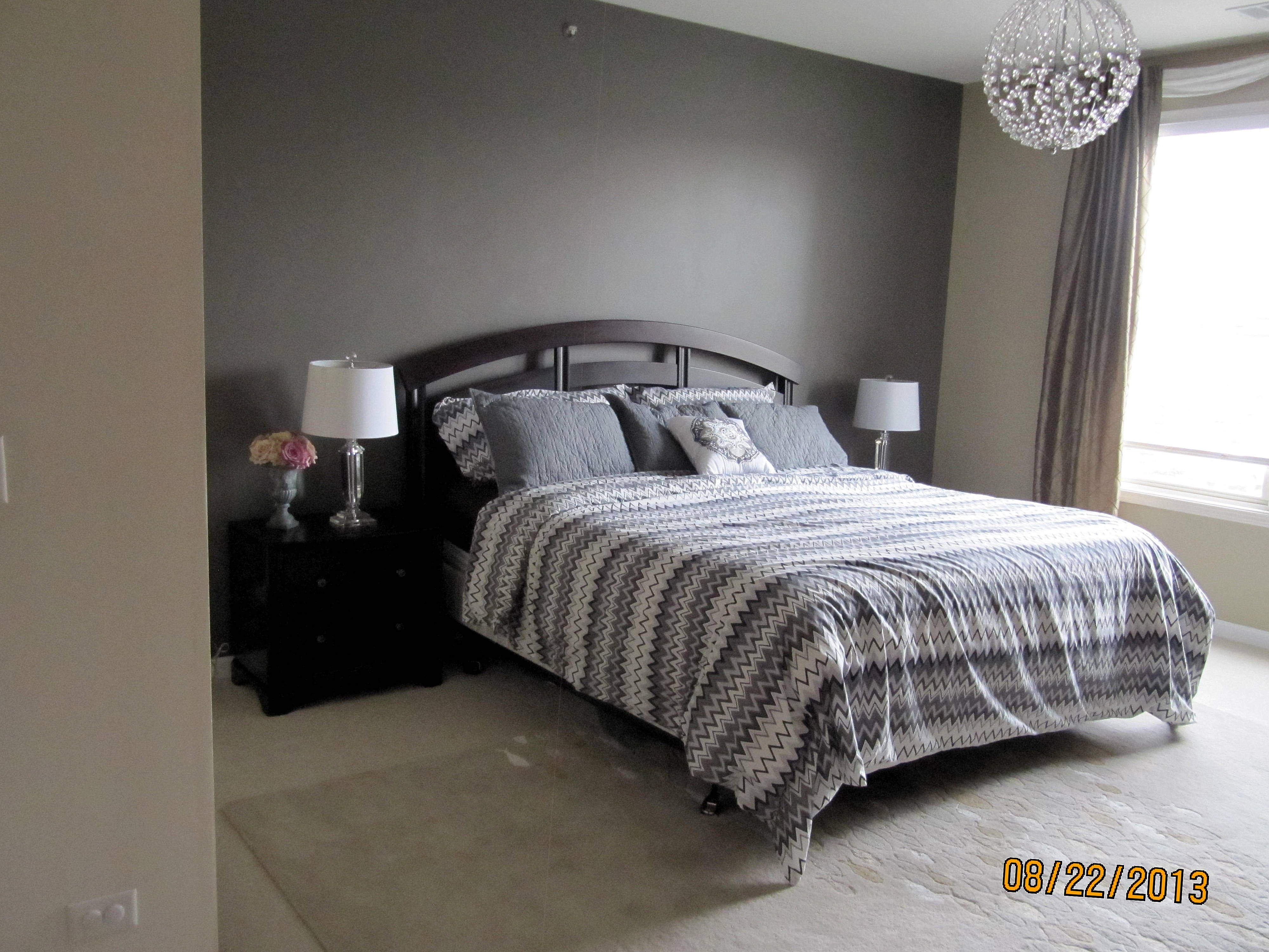 dark gray accent wall with taupe side walls er bedroom
