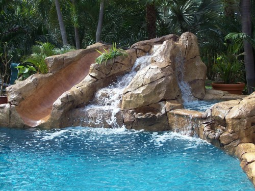 Premier Surfaces Designs And Builds Beautiful Hand Carved Waterfalls For Your Outdoor Environment T Swimming Pool House Swimming Pools Backyard Pool Waterfall