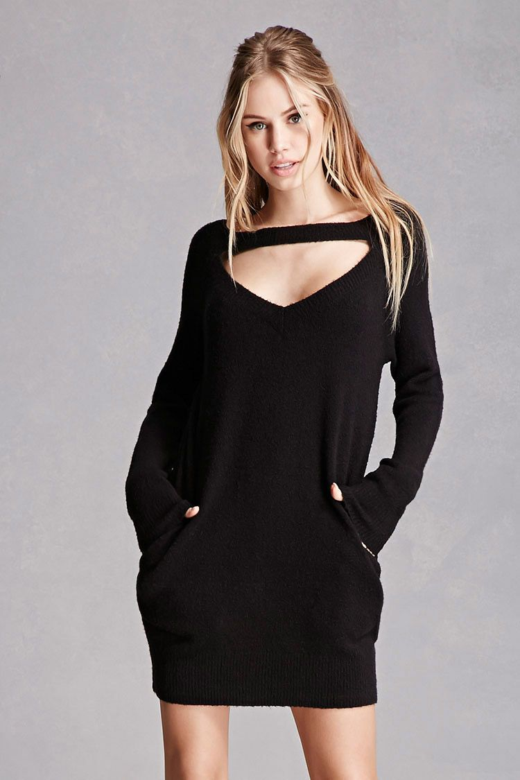 5602849c4ce A knit sweater dress featuring a cutout below the ribbed neckline ...