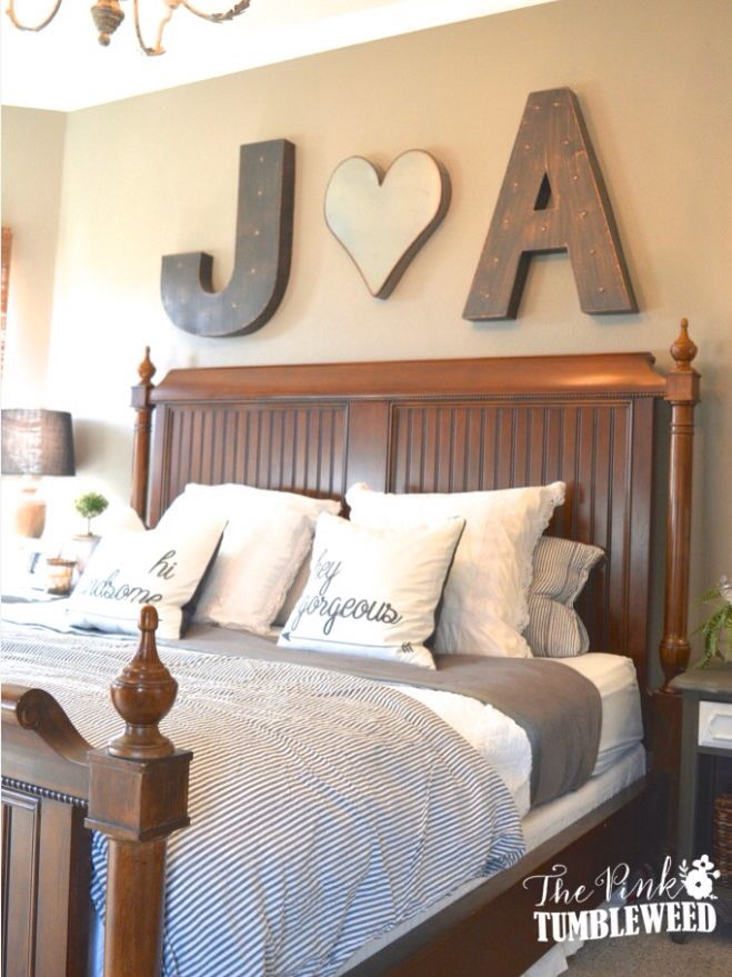 large letters and a heart hung above the bed  Home bedroom