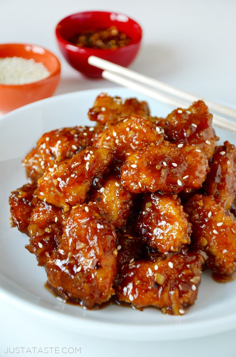 Ditch the deep fryer in favor of an easy recipe for baked orange chicken that's light, crispy and tossed in a tangy sauce. #chineseorangechicken