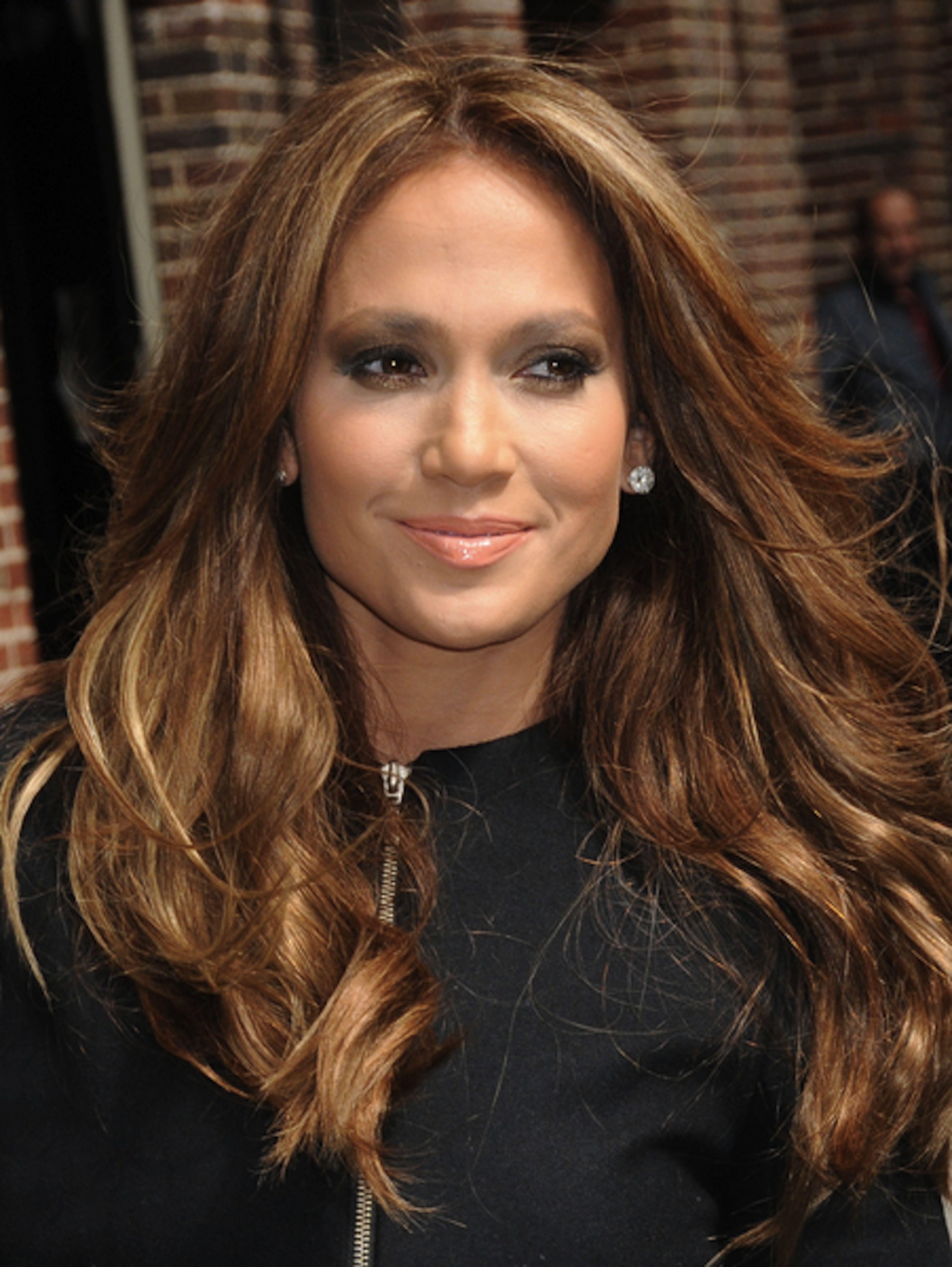 Jennifer Lopez has a warm, golden brown hair color that's