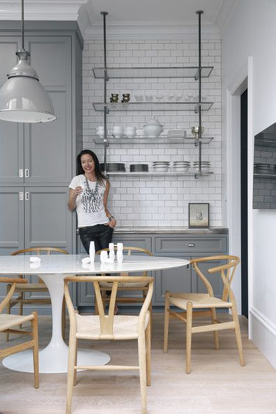 Susan Greenleaf San Francisco Home - Designer and homeowner Susan Greenleaf in her San Francisco kitchen, with gray custom cabinetry, open s...