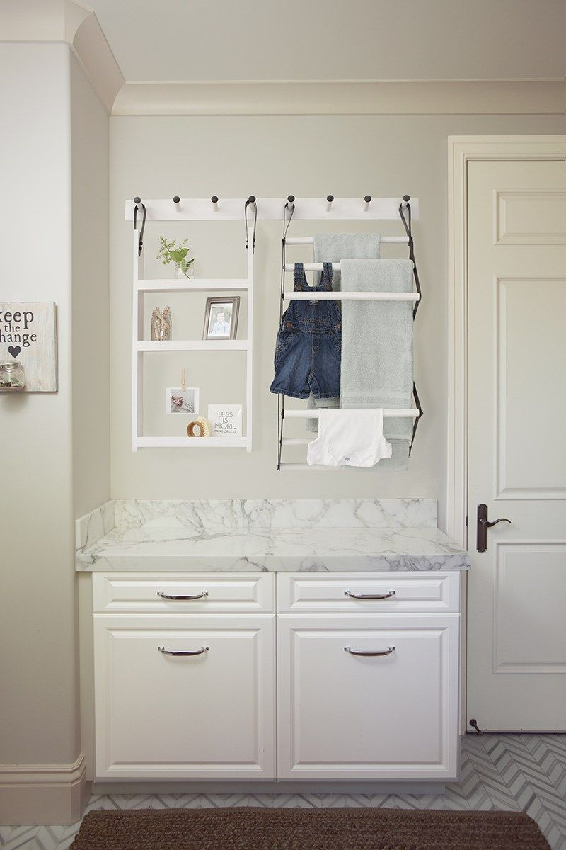 See how a few simple tips and tricks turned this laundry room organization project into one stylish space.