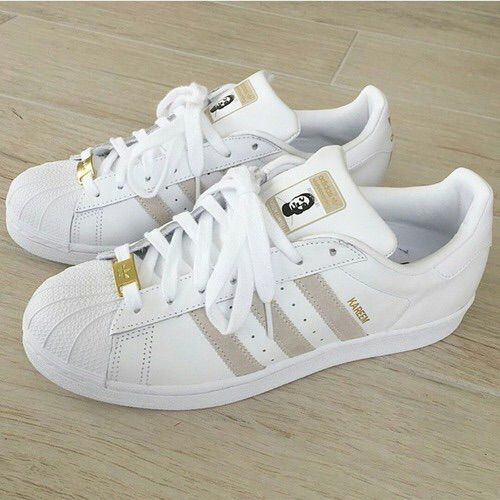 e778c3ffd Image via We Heart It  adidas  fashion  girl  gold  j  outfit  shoes  sport   tupac  white  superstar  kareem