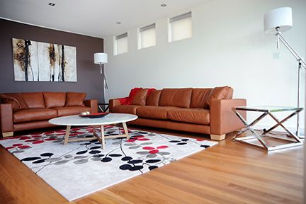 after tan leather sofas add warmth and character akira rug brings interest and colour - Tan Leather Sofa