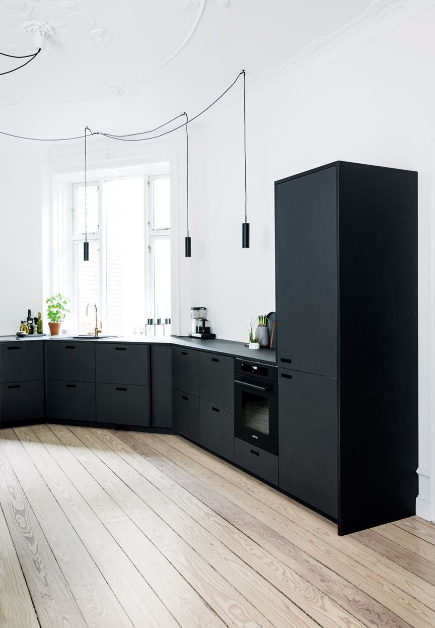 Modern kitchen with cabinetry and drawer fronts in black linoleum ...