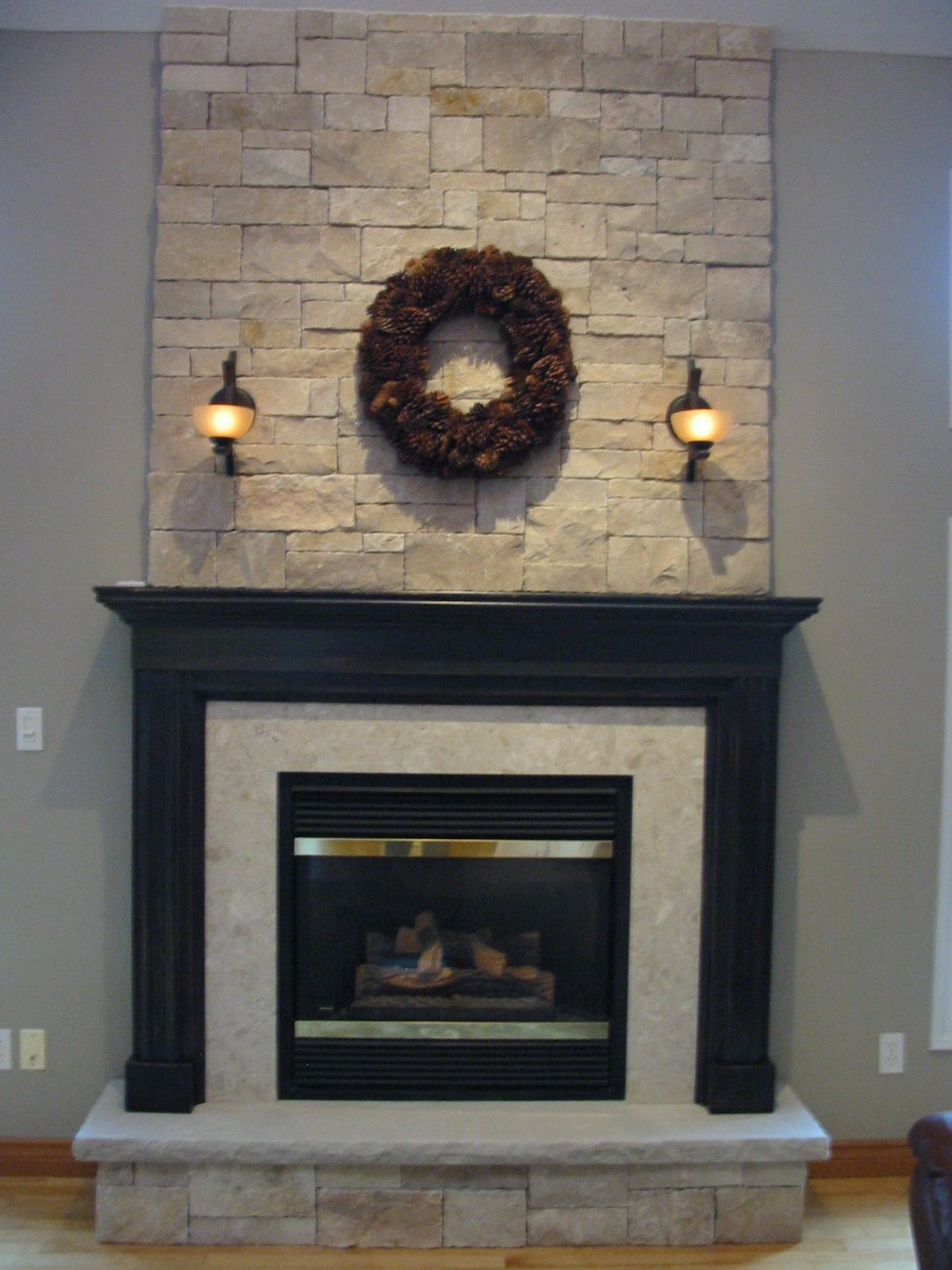 living room interior cool white stone fireplace walls with black