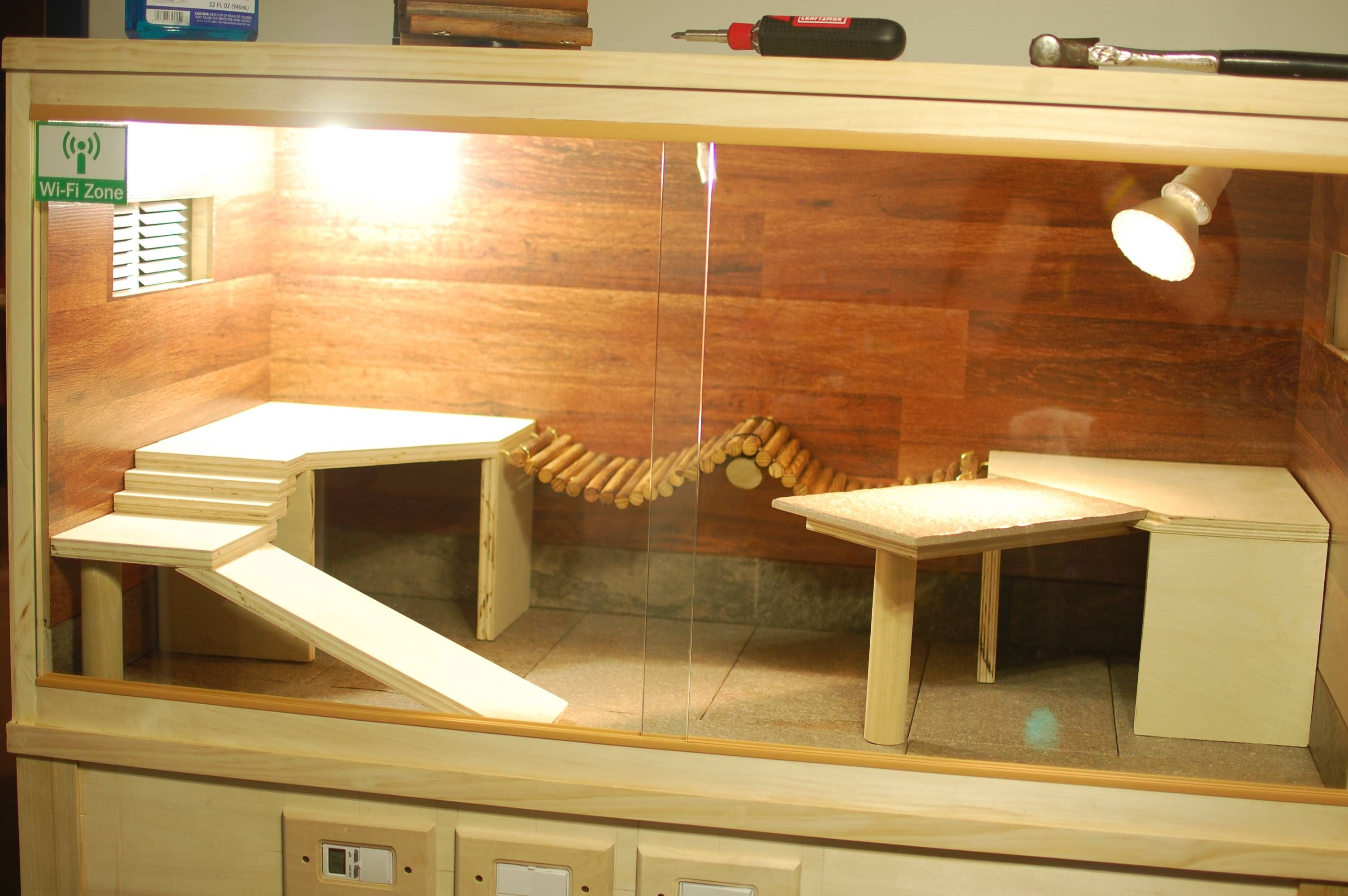 Build ramps and different levels using wood for reptiles