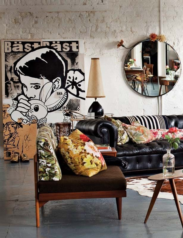 Kitsch Living Space Set In This Industrial Loft Gorgeous Leather Couch Hide Rug