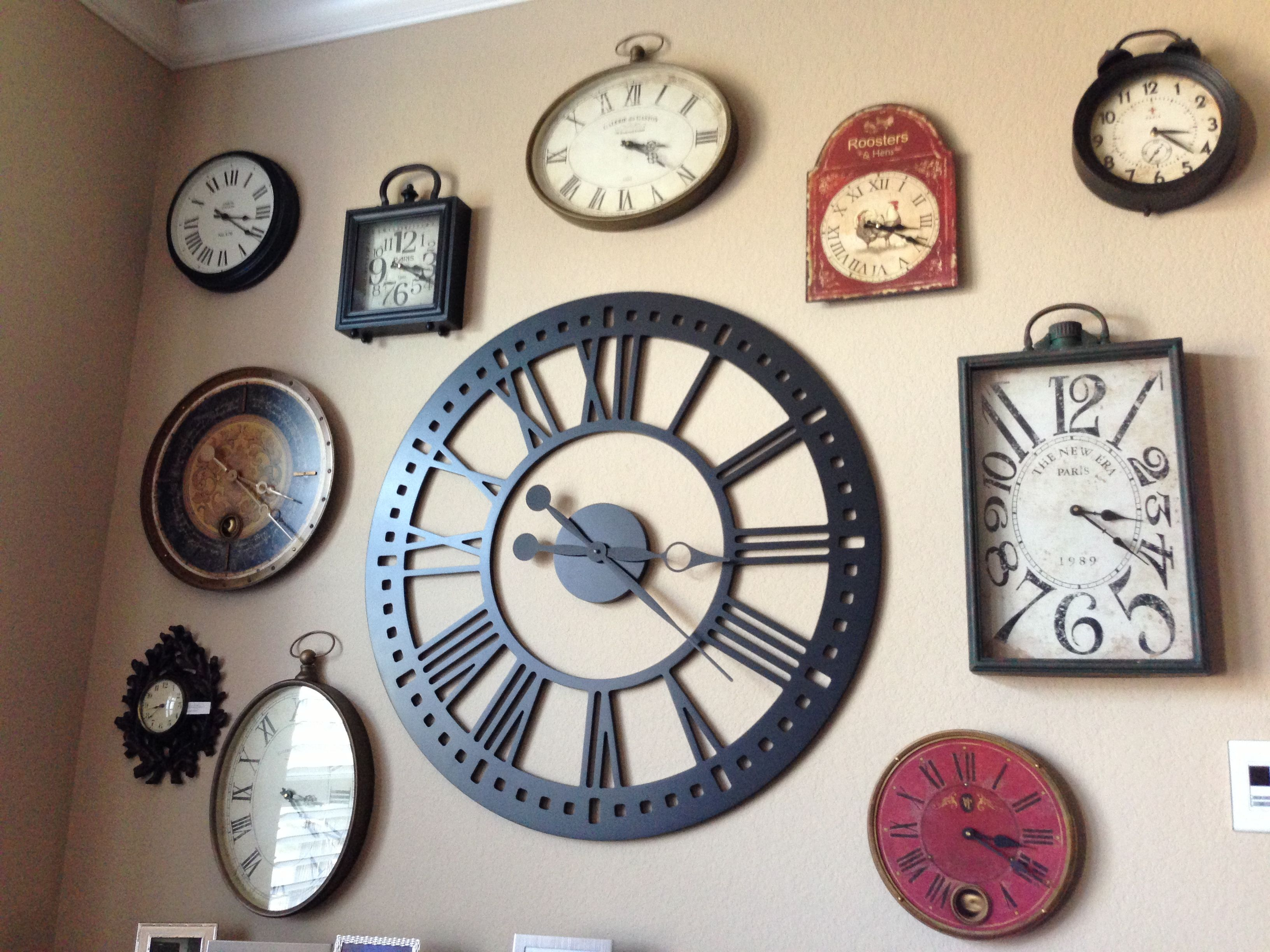 i want a wall of clocks in the living room one of them i