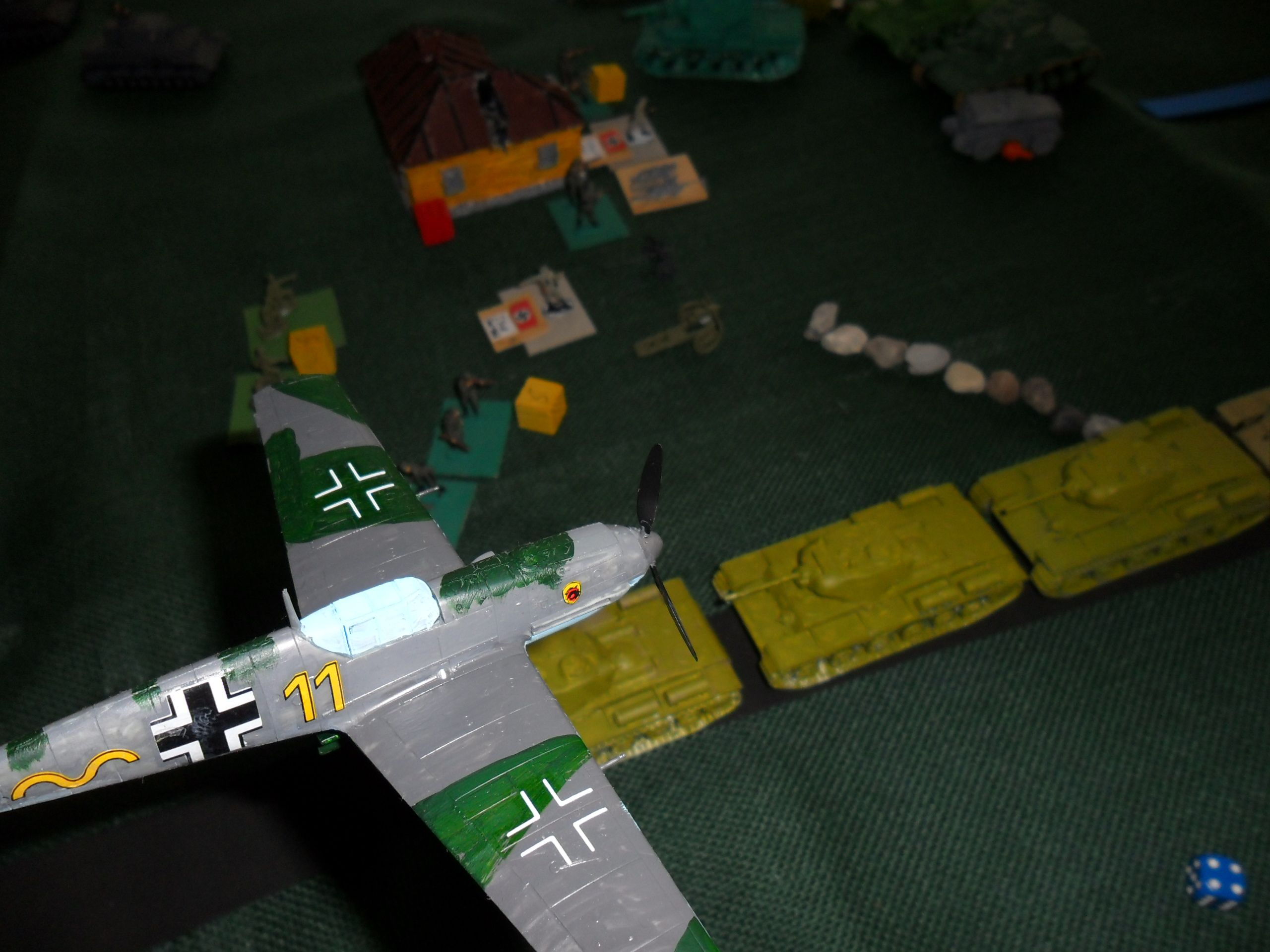 An ME109 flies over Soviet tanks. It's attack had no effect.