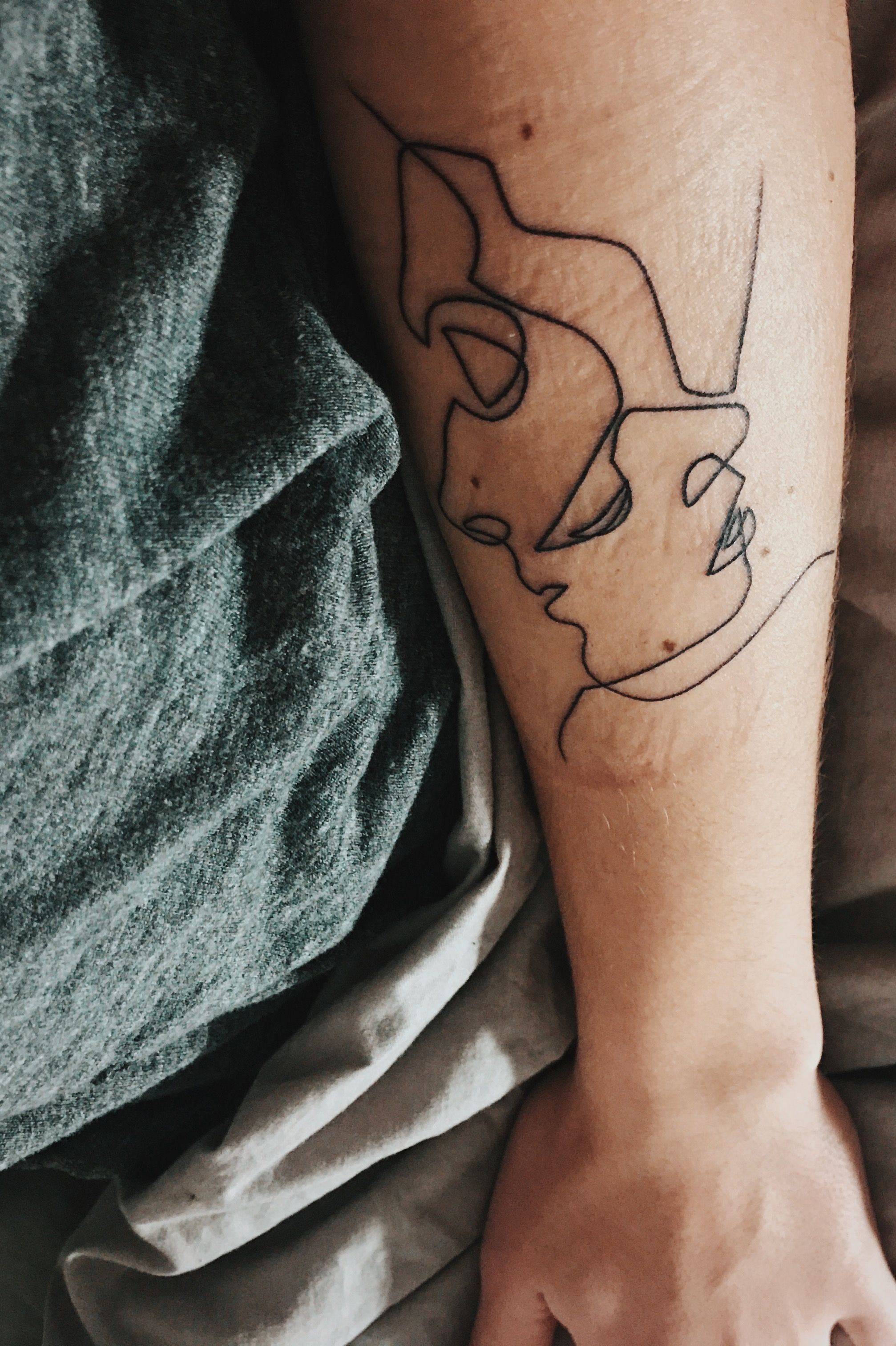7608d066bef88 Two faces one line tattoo forearm | tattoos | One line tattoo, Line ...
