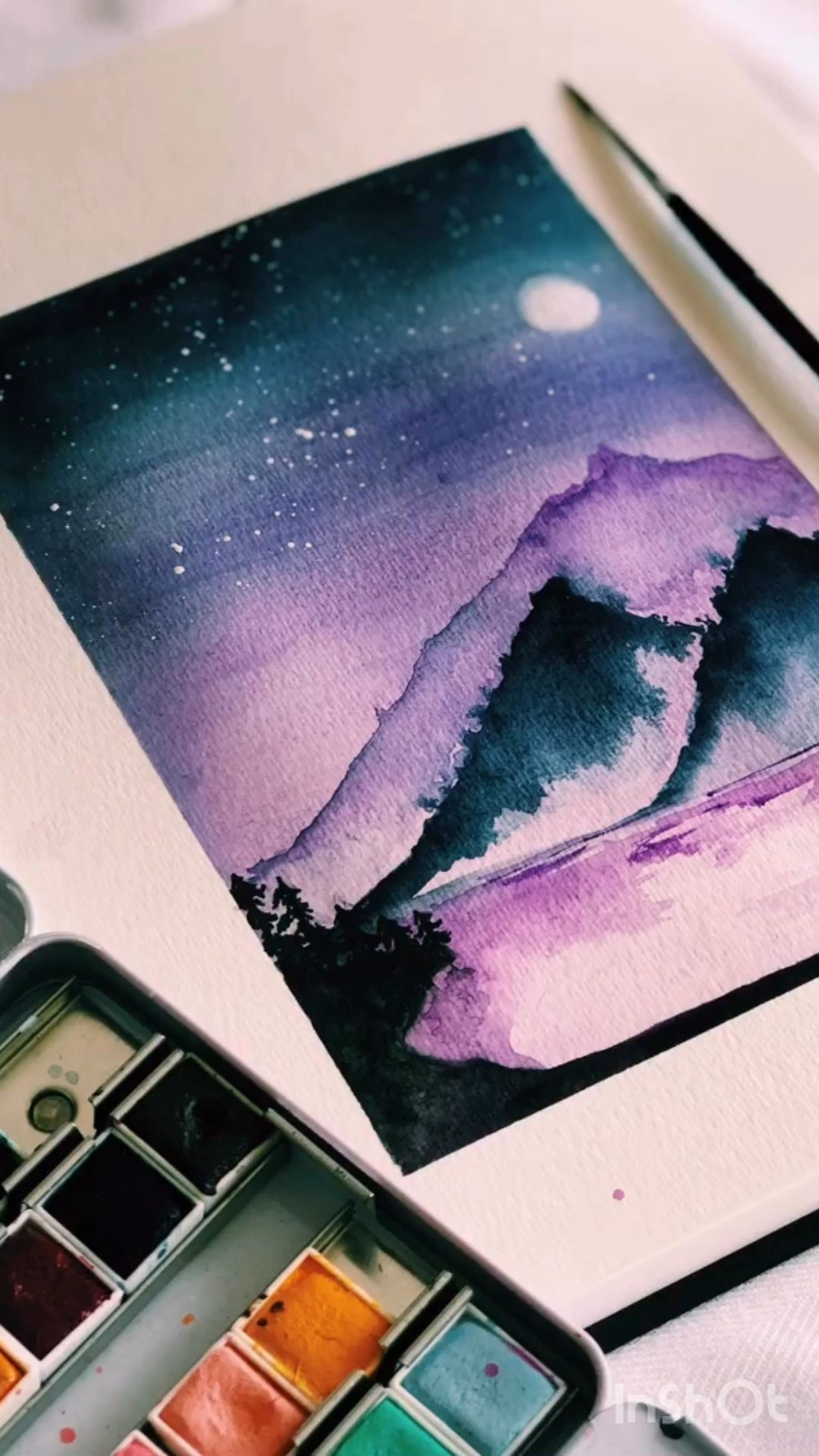 Watercolour mountain scene and night sky