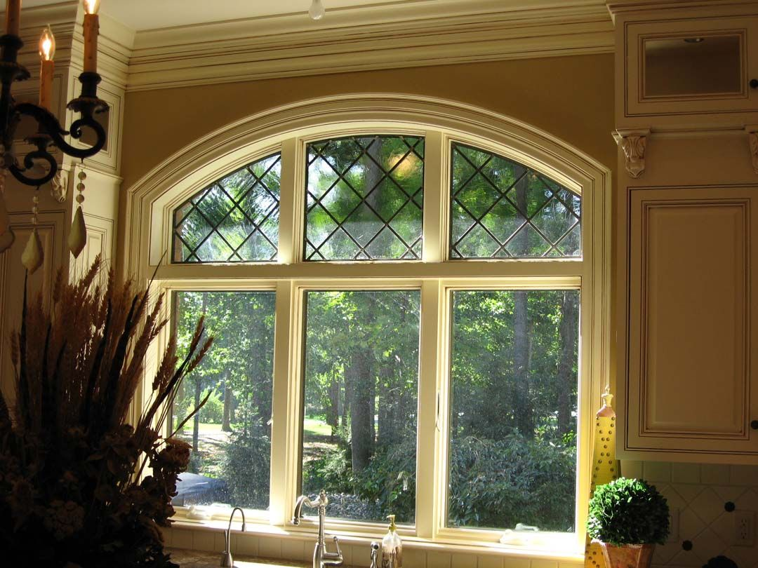 Triple Window With Decorative Black Diamond Grid In The Arched Top