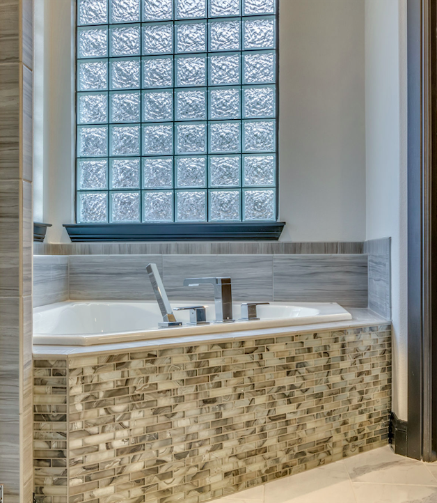 Tiled Corner Bathtub With Modern Faucet And Glass Block Window For Natural Light Bedrock Designs And Builds Custo Modern Tub Modern Faucet Glass Block Windows