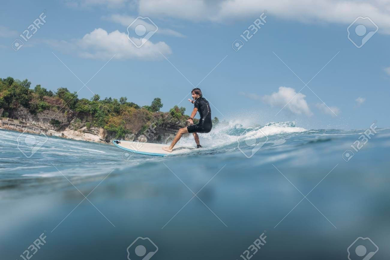 Active man surfing wave on surf board in ocean Stock Photo ,