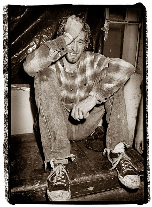 """""""This was in Seattle, 1990. He simply came off stage, sat down and cried for about half a minute. Then he was fine. He had just trashed his gear on stage, and it was simply a release of energy. It is a painful picture, but it's about the angst of performance. The band seemed used to it. He seemed very healthy then, and very happy. He was a very powerful and energetic performer, and it was all he wanted to do. The band was his vehicle, the most important thing in his life."""" - Ian Tilton"""