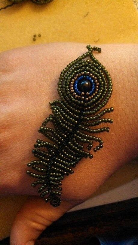 Beaded peacock feather