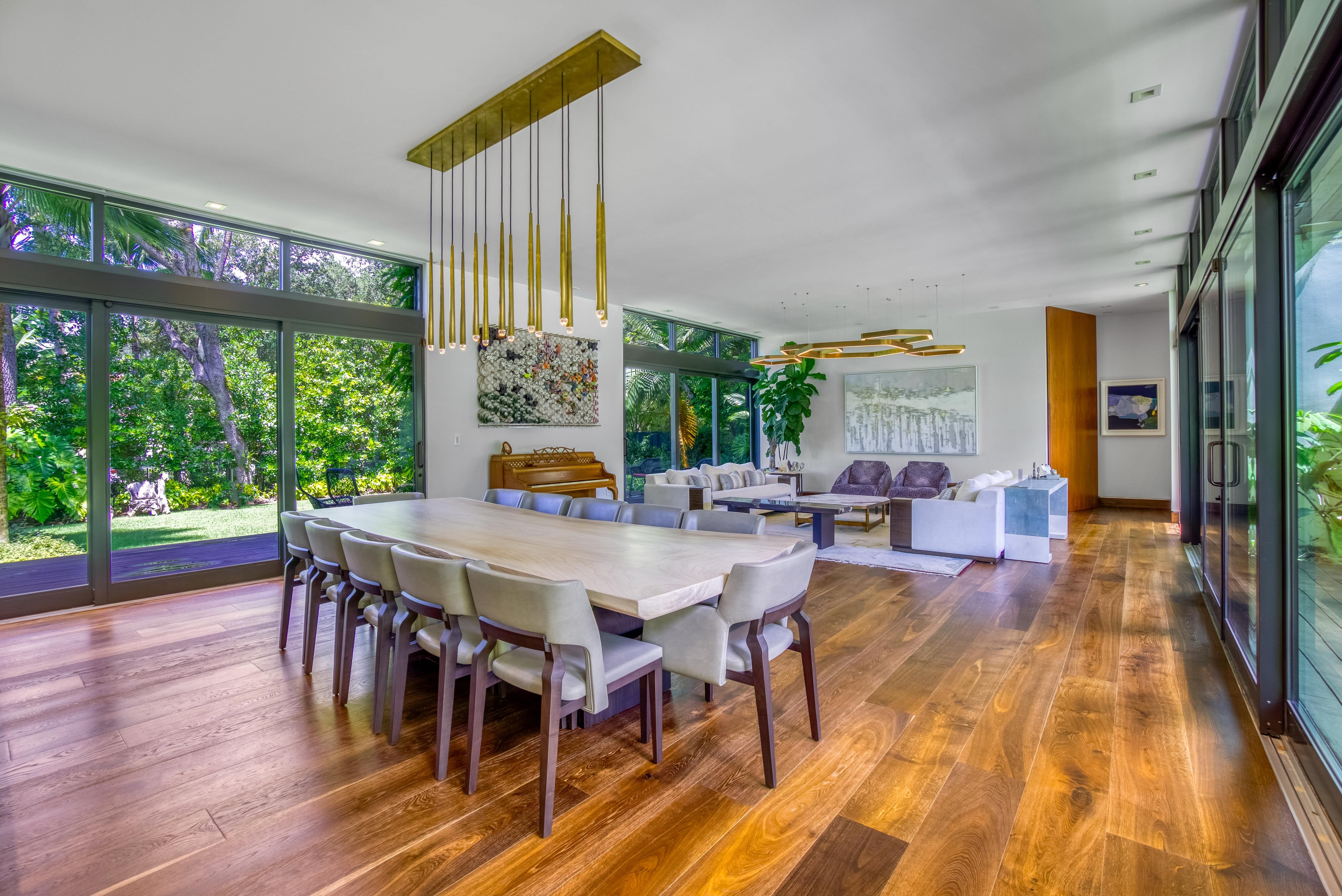 Open space with floor to ceiling windows and hardwood