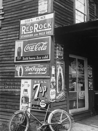 Food Store Called Leo's Place Covered with Beverage Ads Incl. Coca Cola, 7 Up, Dr. Pepper and Pepsi