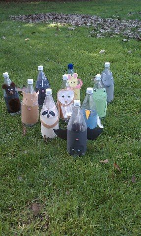 Woodsie Bowling Buddies from recycled water bottles.  Bowl them down or count and reposition them.