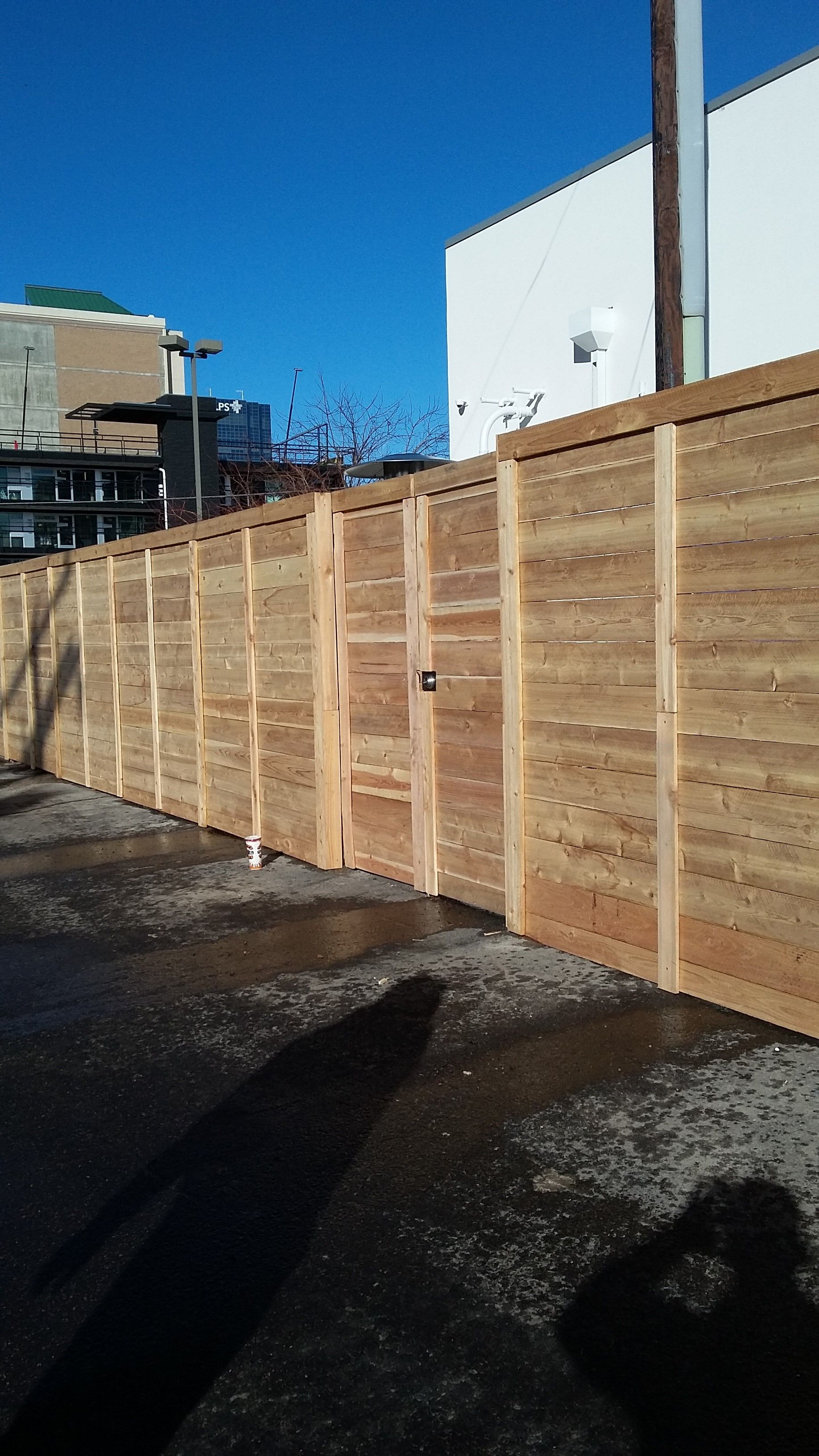 Horizontal fence and gate on metal posts by