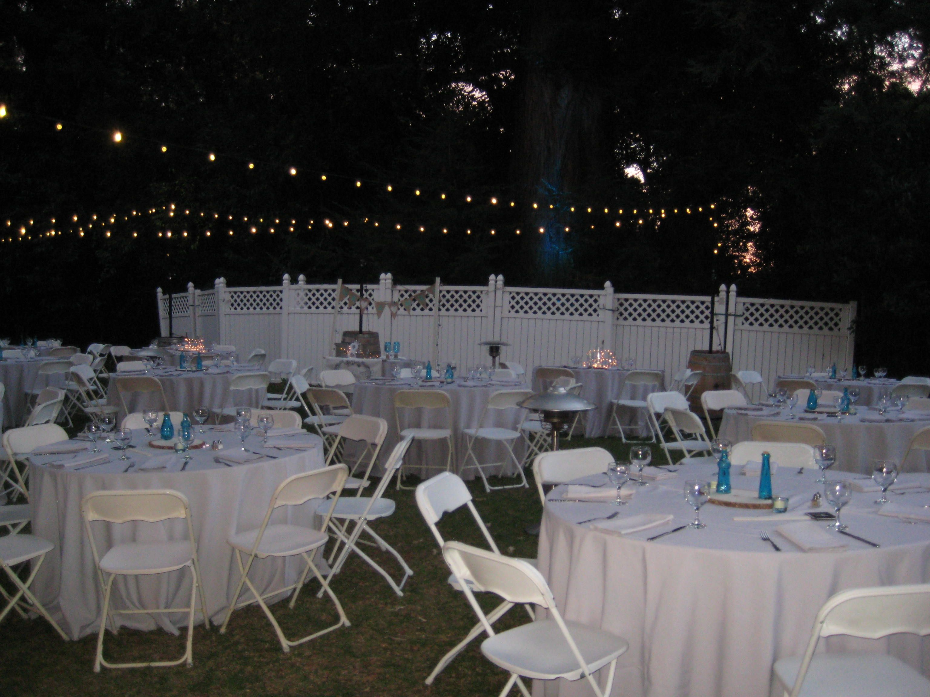 Simple park wedding at Ardenwood. Grey linens. White samsonite chairs.  Lighting by @