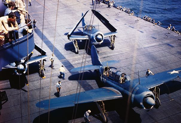 Helldiver Planes on Carrier Deck: Two Navy Helldiver planes on the deck of an aircraft carrier, one with wings extended, one with wings folded. (Photo Credit: Bettmann/CORBIS)