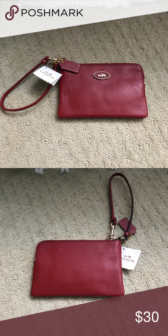 f4b24b8042d75 Tags attached. Red leather Coach Wristlet. Brand new and never used. Tags s  attached. Red leather color Coach Bags Clutches   Wristlets