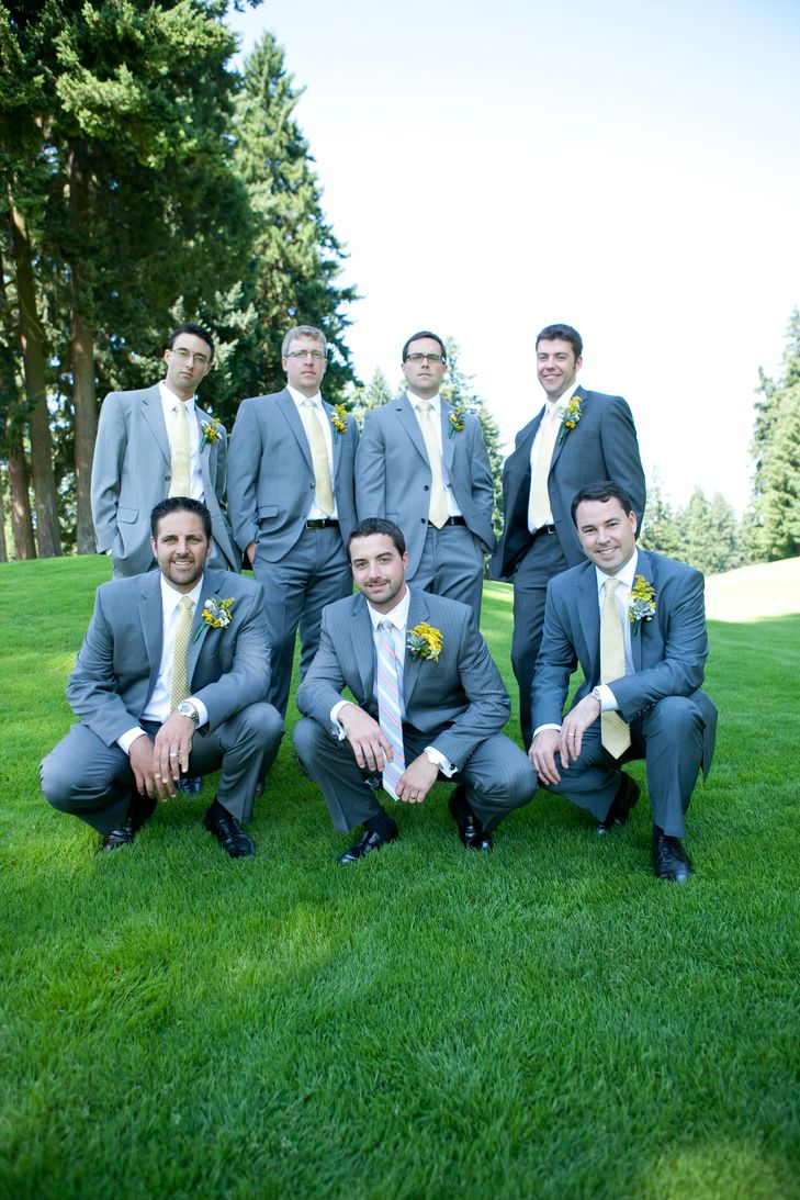 Gray suits with yellow boutonnieres. Groom wore striped tie. | Groom ...