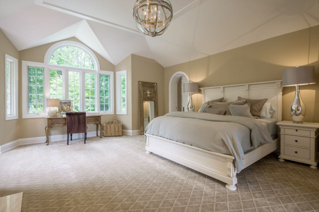 Traditional Master Bedroom With Vaulted Ceiling French Doors
