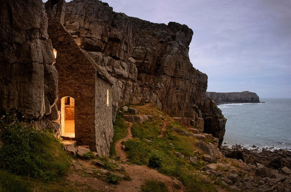 St. Govan's Chapel is a chapel located at St. Govan's Head, Pembrokeshire in south west Wales. Built into the side of a limestone cliff, the building measures 20 by 12 feet (6.1 m × 3.7 m) with walls constructed from limestone, and consists of two chambers, one in the front and one in the back.[1] The majority of the chapel was built in the thirteenth century, although parts of it may date back further to the sixth century when Saint Govan, a monk moved into a cave located on the site of the…