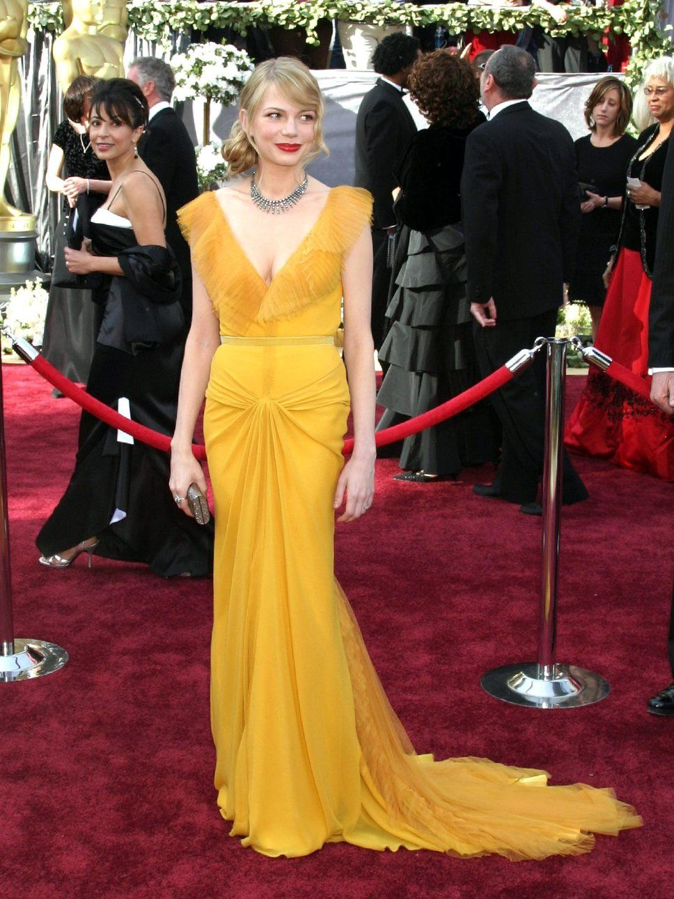 58ad881f0d4 michelle williams  mustard dress remains one of my favorite red carpet  looks of all time.