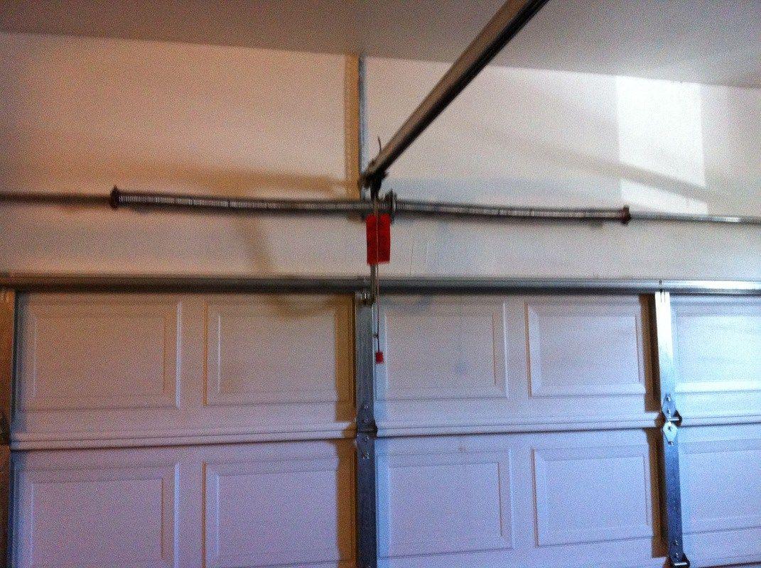 What Is The Function Of The Garage Door Torsion Springs And How To Repair It Lightho Garage Door Spring Repair Garage Door Torsion Spring Broken Garage Door