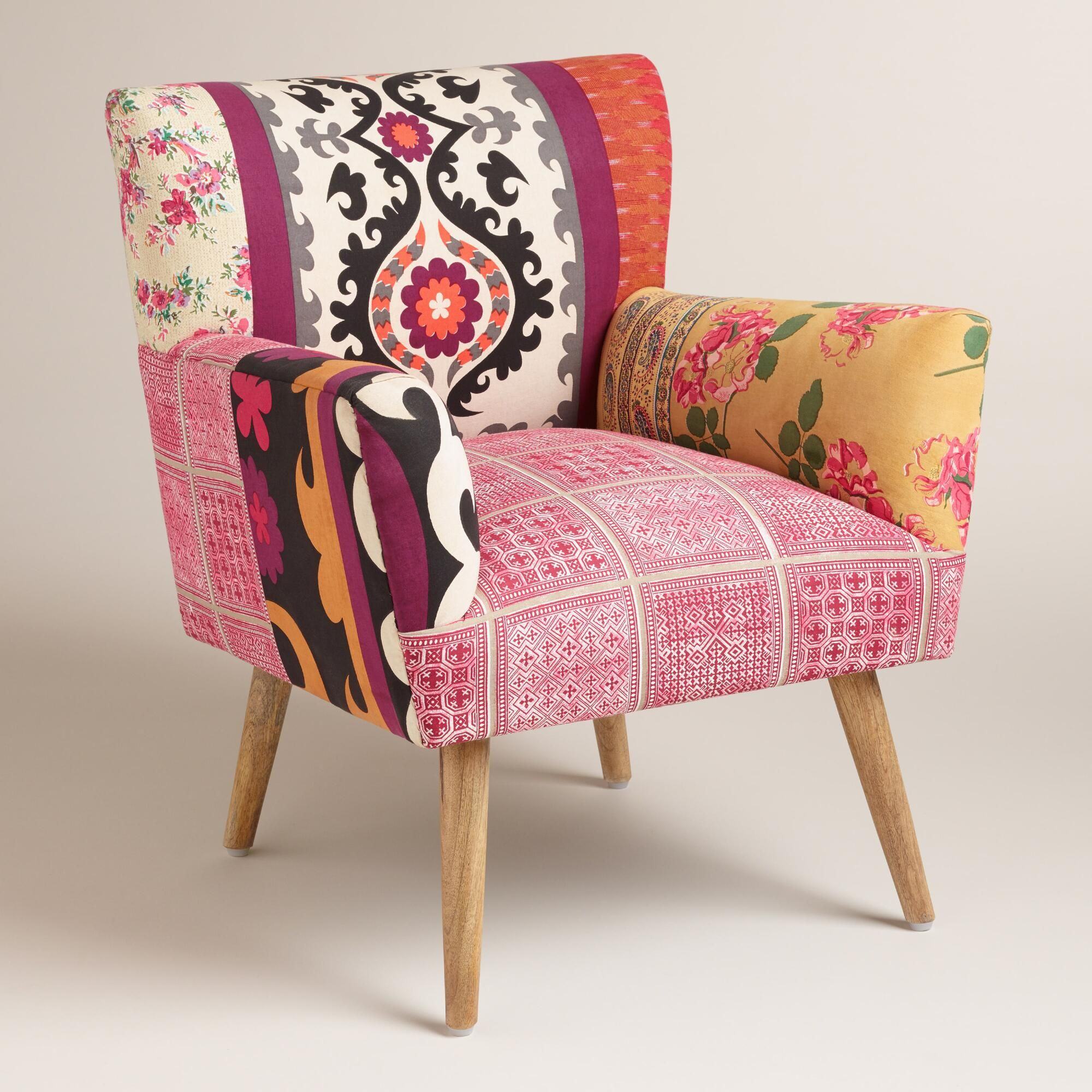 An eclectic mix of prints and colors gives our accent chair a bohemian feel its petite vintage inspired profile and slightly splayed mango wood legs add